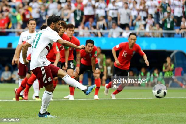 Carlos Vela of Mexico scores the opening goal from a penalty during the 2018 FIFA World Cup Russia group F match between Korea Republic and Mexico at...