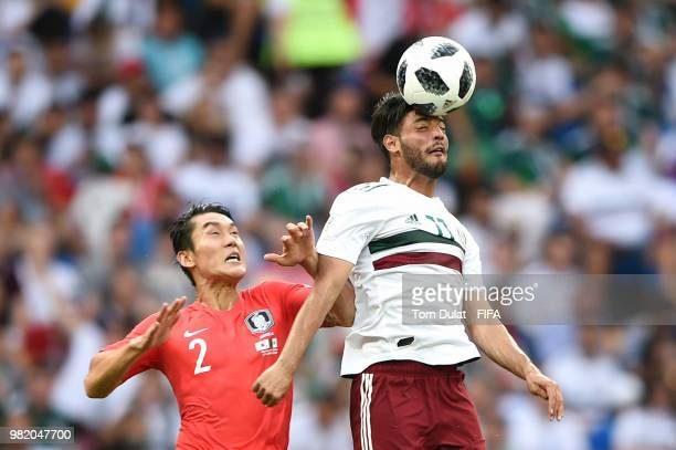 Carlos Vela of Mexico wins a header over Yong Lee of Korea Republic during the 2018 FIFA World Cup Russia group F match between Korea Republic and...