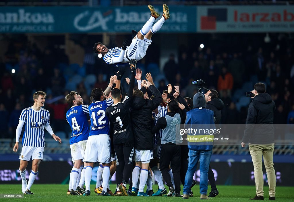 Carlos Vela of Real Sociedad (C) is honored by his teammates on his last match as player of Real Sociedad during the La Liga match between Real Sociedad and Sevilla at on December 20, 2017 in San Sebastian, .