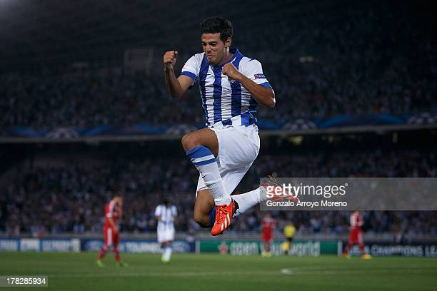 Carlos Vela of Real Sociedad jumps while celebrating scoring their second goal during the UEFA Champions League Playoffs second leg match between...