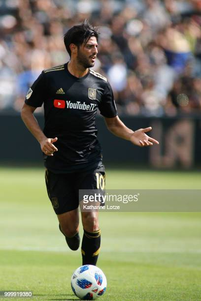 Carlos Vela of the Los Angeles Football Club dribbles down the field during action against the Portland Timbers at Banc of California Stadium on July...