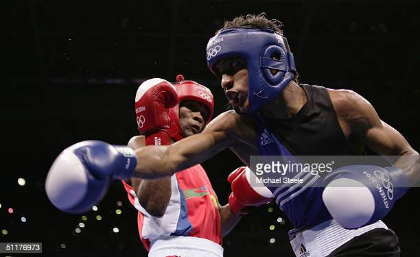 Carlos Velazquez of Puerta Rica fights with Edvaldo Oliveira of Brazil during the men's boxing 57 kg preliminary bout on August 16 2004 during the...