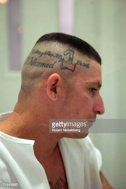 Carlos Ventura shows off tattoos made on his scalp saying 'Waiting For My Death' and 'My Death Be Welcomed' from a visiting cell in a maximum...