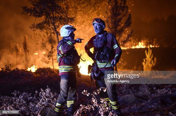 Carlos Vieira 2nd commander of Trafaria fire department talks with a college after more then 24 hours fighting the fire in Portugal on June 18 2017...