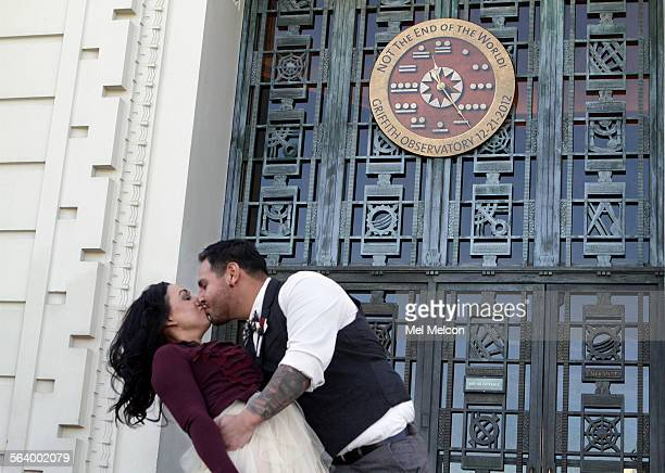 Carlos Villa kisses his new bride Ashleigh Villa after a wedding ceremony in front of the entrance to the Griffith Observatory on December 21 2012 In...