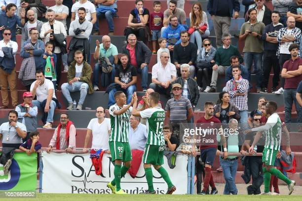 Carlos Vinicius of Rio Ave FC celebrates with teammate Joao Schmidt of Rio Ave FC after scoring a goal during the Portuguese Cup match between SCU...