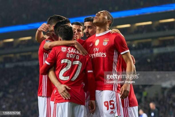 Carlos Vinicius of SL Benfica celebrates with his team mates after scoring his team's first goal during the Liga Nos match between FC Porto and SL...
