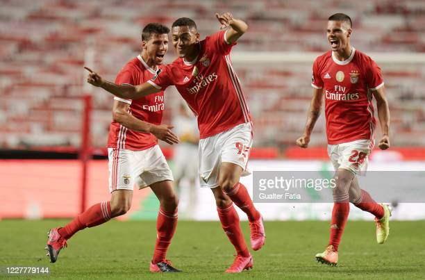 Carlos Vinicius of SL Benfica celebrates with teammates after scoring a goal during the Liga NOS match between SL Benfica and Sporting CP at Estadio...