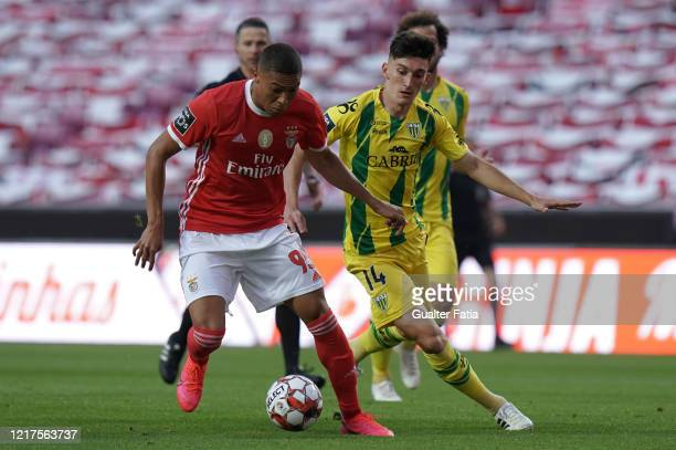 Carlos Vinicius of SL Benfica competes for the ball with Pepelu of CD Tondela during the Liga NOS match between SL Benfica and CD Tondela at Estadio...