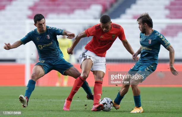 Carlos Vinicius of SL Benfica with Andre Castro of SC Braga and Andre Horta of SC Braga in action during the Pre Season Friendly match between SL...