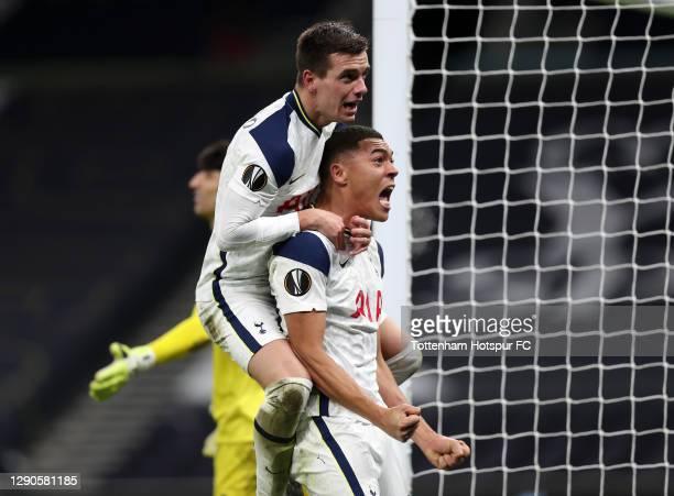 Carlos Vinicius of Tottenham Hotspur celebrates with Giovani Lo Celso of Tottenham Hotspur after scoring his sides 1st goal after scoring their...