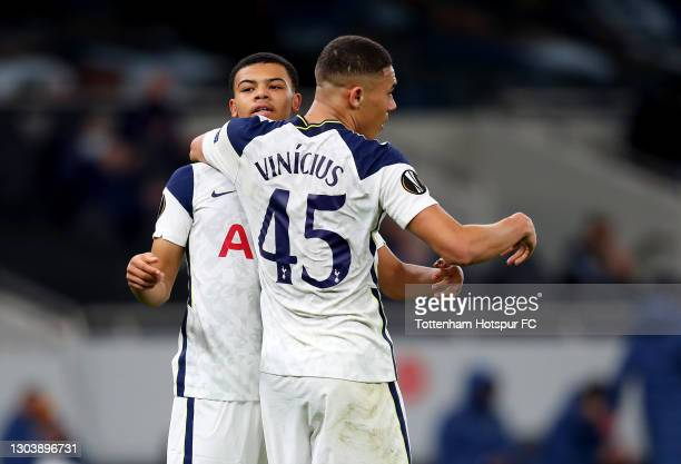 Carlos Vinicius of Tottenham Hotspur is congratulated by team mate Dane Scarlett after scoring their side's fourth goal during the UEFA Europa League...