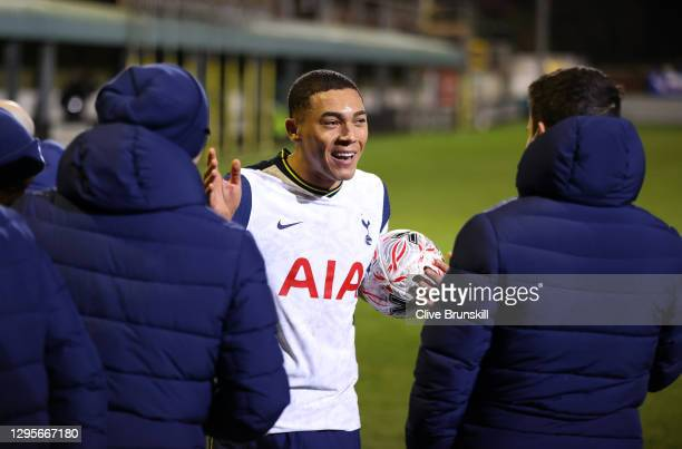 Carlos Vinicius of Tottenham Hotspur reacts as he collects the match ball from teammates after scoring a hat-trick following the FA Cup Third Round...