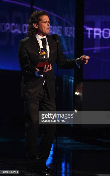 Carlos Vive accepts the Grammy for Best Contemporary Tropical Album during the 15th Annual Latin Grammy Awards on November 20 in Las Vegas Nevada AFP...