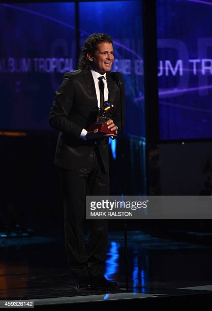 Carlos Vives accepts the Grammy for Best Contemporary Tropical Album during the 15th Annual Latin Grammy Awards on November 20 in Las Vegas Nevada...