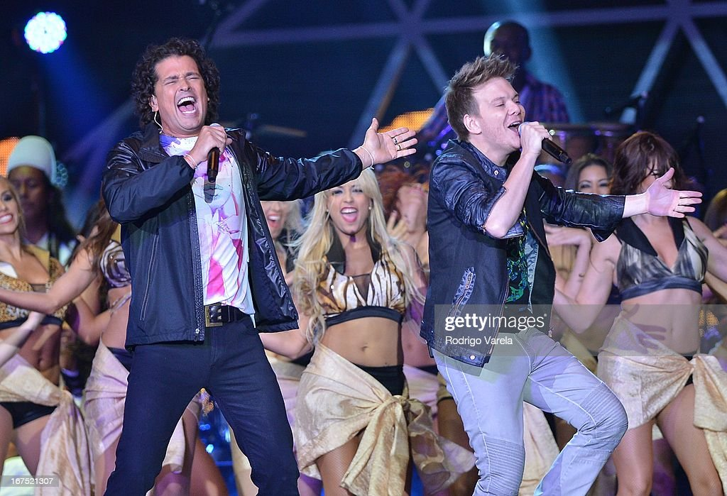 Carlos Vives and Michel Telo perform at Billboard Latin Music Awards 2013 at Bank United Center on April 25, 2013 in Miami, Florida.