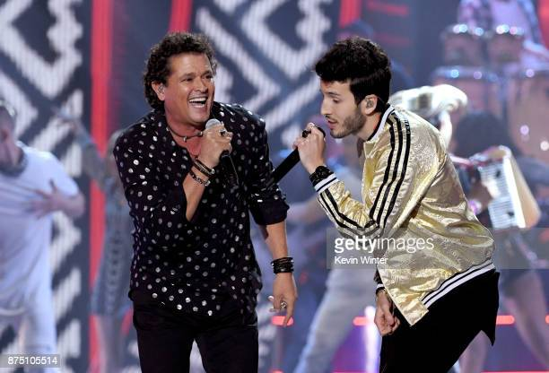 Carlos Vives and Sebastian Yatra perform onstage at the 18th Annual Latin Grammy Awards at MGM Grand Garden Arena on November 16 2017 in Las Vegas...