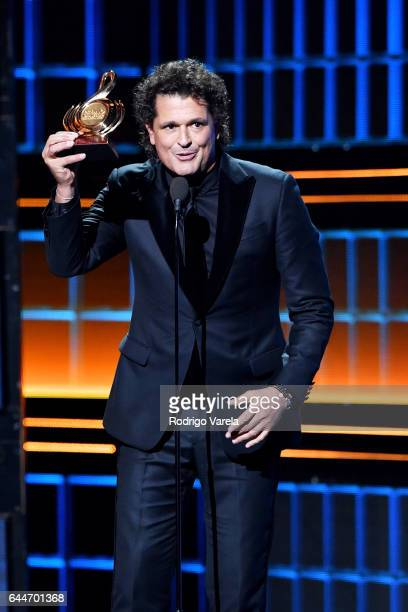 Carlos Vives receives award onstage during Univision's 29th Edition of Premio Lo Nuestro A La Musica Latina at the American Airlines Arena on...