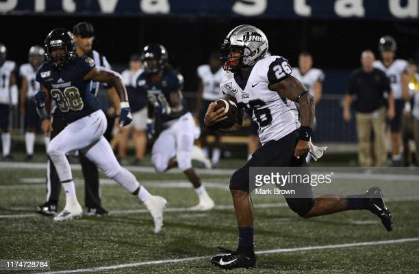 Carlos Washington Jr. #26 of the New Hampshire Wildcats runs with the ball in the second half against the FIU Golden Panthers at Ricardo Silva...