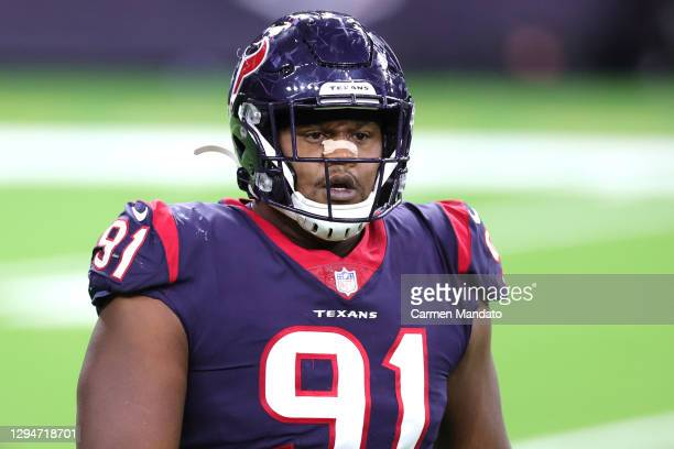 Carlos Watkins of the Houston Texans in action against the Tennessee Titans during a game at NRG Stadium on January 03, 2021 in Houston, Texas.