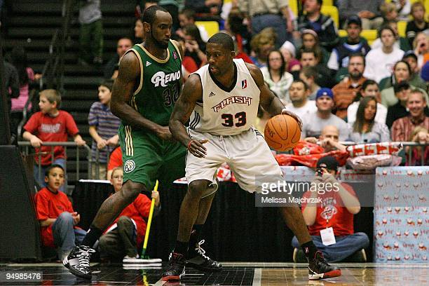 Carlos Wheeler of the Utah Flash drives the ball against Doug Thomas of the Reno Bighorns during the D-League game on December 11, 2009 at the McKay...
