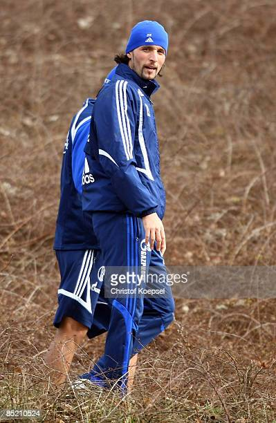 Carlos Zambrano and Kevin Kuranyi walk to the cabin after the training session of FC Schalke on the training ground at the Veltins Arena on March 4,...