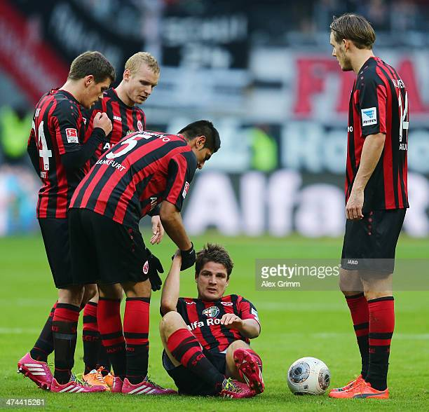 Carlos Zambrano helps up team mate Pirmin Schwegler of Frankfurt during the Bundesliga match between Eintracht Frankfurt and Werder Bremen at...