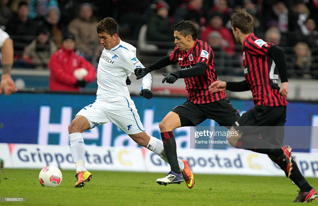Carlos Zambrano of Frankfurt challenges Roberto Firmino (L) of Hoffenheim during the Bundesliga match between Eintracht Frankfurt and 1899 Hoffenheim at Commerzbank-Arena on January 26, 2013 in Frankfurt am Main, Germany.