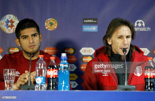 Carlos Zambrano of Peru and Ricardo Gareca coach of Peru talk during a press conference prior to the semi final match against Chile at Nacional...