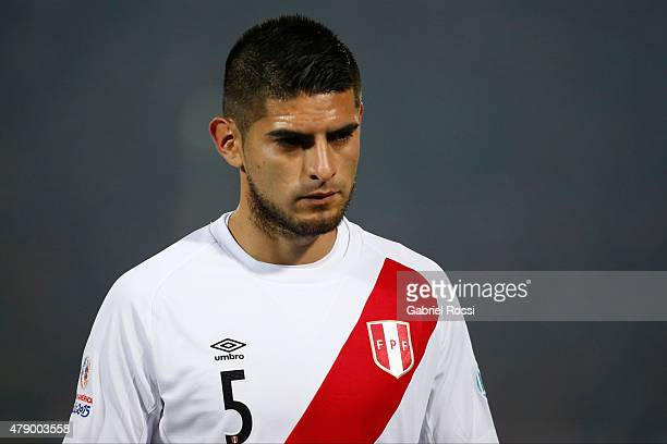Carlos Zambrano of Peru leaves the field after being sent off during the 2015 Copa America Chile Semi Final match between Chile and Peru at Nacional...