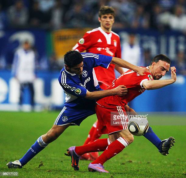 Carlos Zambrano of Schalke challenges Franck Ribery of Muenchen during the DFB Cup semi final match between FC Schalke 04 and FC Bayern Muenchen at...