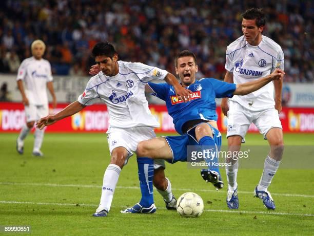 Carlos Zambrano of Schalke fouls Vedad Ibisevic of Hoffenheim during the Bundesliga match between 1899 Hoffenheim and FC Schalke 04 at RheinNeckar...