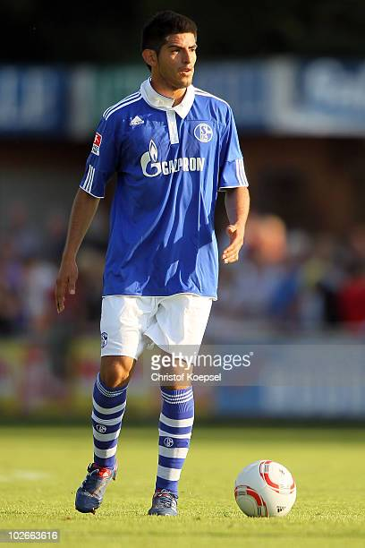 Carlos Zambrano of Schalke runs with the ball during the friendly match between VfB Huels and FC Schalke at the Badeweiher stadium on July 6 2010 in...