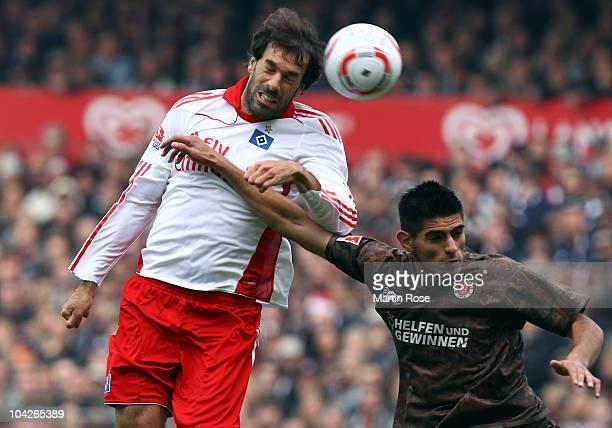 Carlos Zambrano of St Pauli and Ruud van Nistelroy of Hamburg battle for the ball during the Bundesliga match between FC St Pauli and Hamburger SV at...