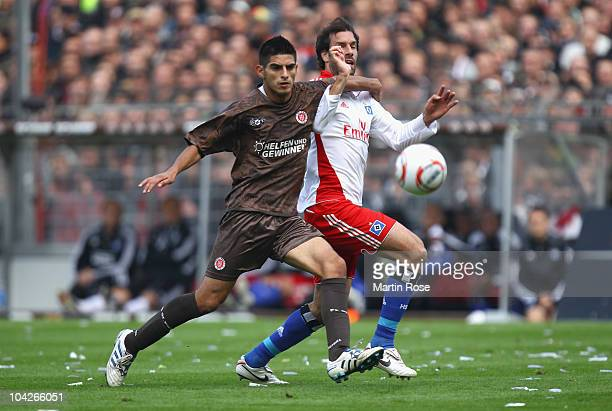 Carlos Zambrano of St Pauli and Ruud van Nistelroy of Hamburg battle for the ball during the Bundesliga match between FC St Pauli and Hamburger SV at...