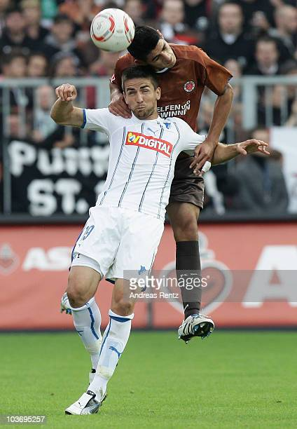 Carlos Zambrano of St. Pauli challenges for a header with Vedad Ibisevic of Hoffenheim during the Bundesliga match between FC St. Pauli Hamburg...