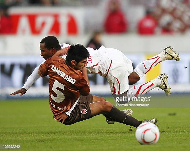 Carlos Zambrano of St. Pauli fights for the ball with Cacau of Stuttgart during the Bundesliga match between VfB Stuttgart and FC St. Pauli at...