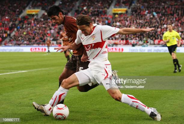 Carlos Zambrano of St. Pauli fights for the ball with Christian Gentner of Stuttgart during the Bundesliga match between VfB Stuttgart and FC St....