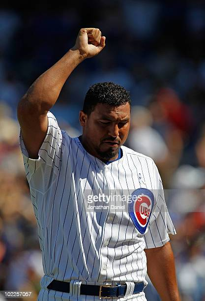 Carlos Zambrano of the Chicago Cubs celebrates getting out of an inning-ending jam against the Los Angeles Angels of Anaheim at Wrigley Field on June...