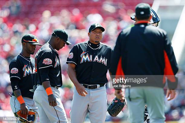 Carlos Zambrano of the Miami Marlins awaits a visit to the mound from pitching coach Randy St Claire after giving up three runs in the first inning...