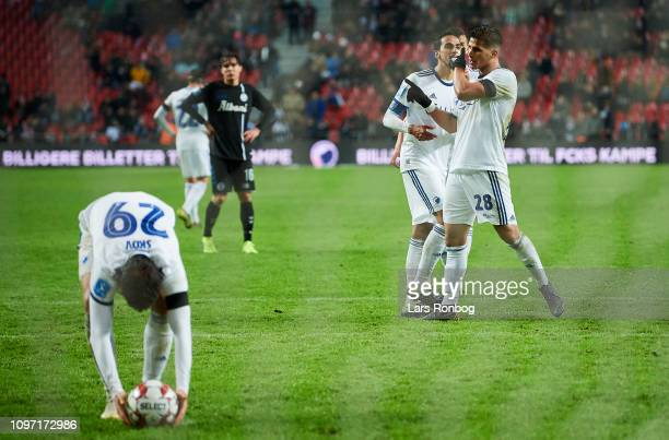 Carlos Zeca and Andreas Bjelland in discussion with Pieros Sotiriou of FC Copenhagen while Robert Skov of FC Copenhagen prepare for a penalty during...