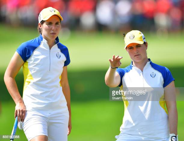Carlota Ciganda and Caroline Masson of Team Europe discuss a shot during the morning foursomes matches of The Solheim Cup at Des Moines Golf and...