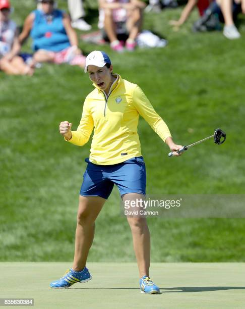 Carlota Ciganda of Spain and the European Team celebrates a birdie putt on the 10th hole in her match with Melissa Reid against Brittany Lang and...