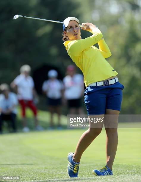 Carlota Ciganda of Spain and the European Team plays her second shot on the 12th hole in her match with Melissa Reid against Brittany Lang and...