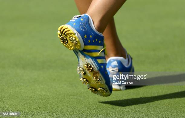 Carlota Ciganda of Spain and the European Team wears patriotic shoes on the 12th hole in her match with Caroline Masson against Danielle Kang and...