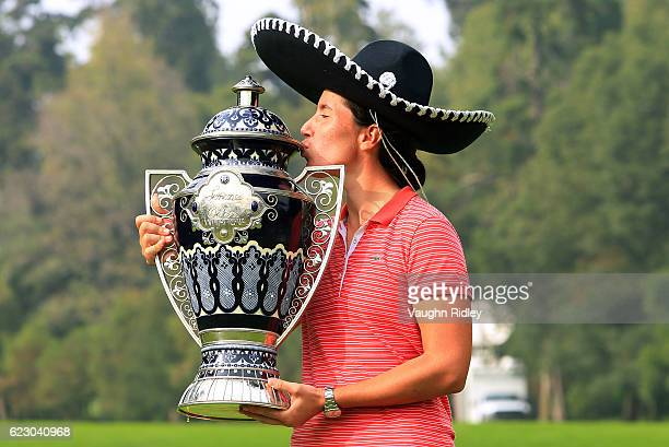 Carlota Ciganda of Spain celebrates with the winners trophy following the final round of the Citibanamex Lorena Ochoa Invitational Presented By...
