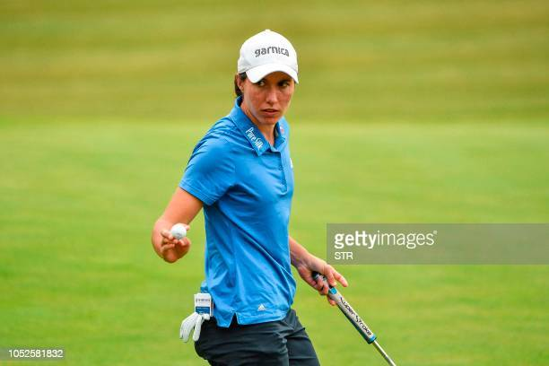 Carlota Ciganda of Spain gestures during round four of the Shanghai LPGA golf tournament in Shanghai on October 20 2018 / China OUT
