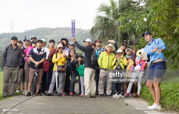 Carlota Ciganda of Spain hits a shot from a cart path next to the 4th fairway during day three of the Swinging Skirts LPGA Taiwan Championship on...