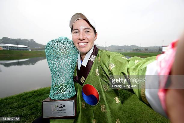 Carlota Ciganda of Spain imitates a selfie as she poses with the trophy during a ceremony following the LPGA KEBHana Bank Championship at the Sky 72...