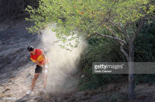 Carlota Ciganda of Spain plays her second shot at the par 4 8th hole during the third round of the 2012 Omega Dubai Ladies Masters on the Majilis...